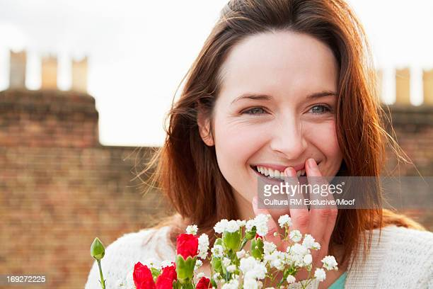 Young woman with bunch of flowers