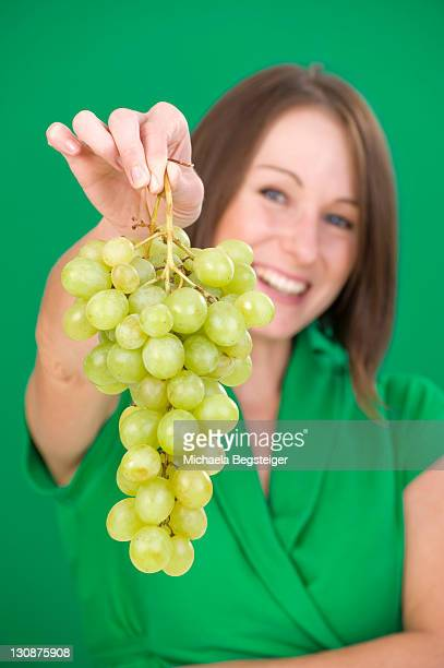 Young Woman With Bunch Of Grapes Stock Photo Getty Images