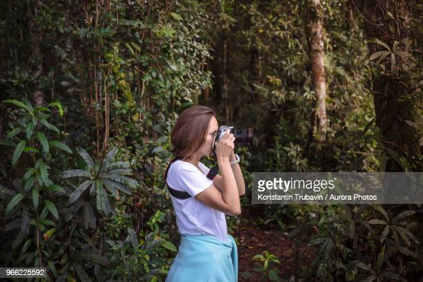 Young woman with camera.