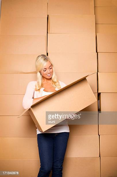 young woman with cardboard boxes - self storage stock pictures, royalty-free photos & images