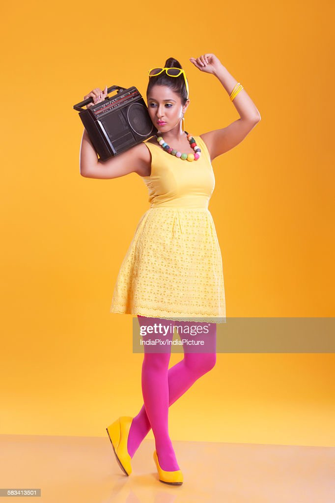 Young woman with cassette player enjoying : Stock Photo
