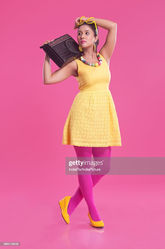 Young woman with cassette player : Stock Photo