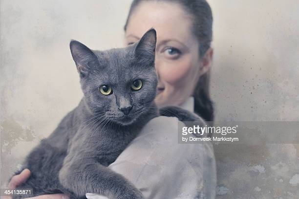 young woman with cat - russian blue cat stock pictures, royalty-free photos & images