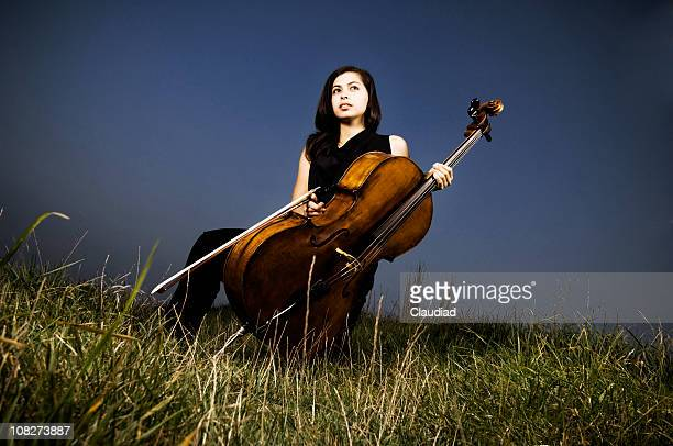 Young woman with cello outdoor