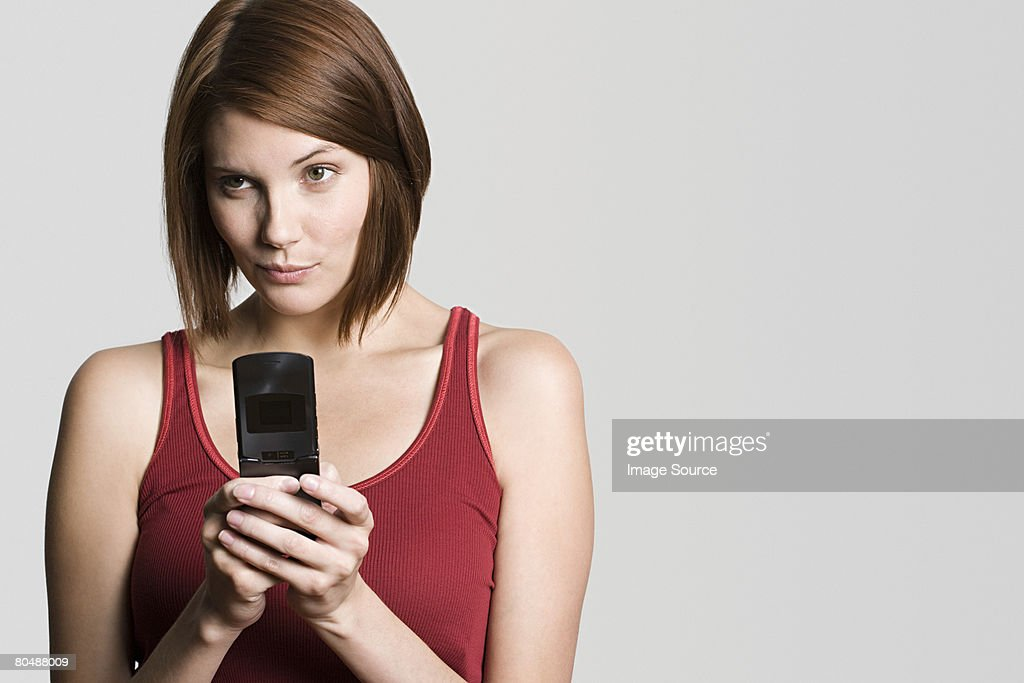 Young woman with cellphone : Stock Photo