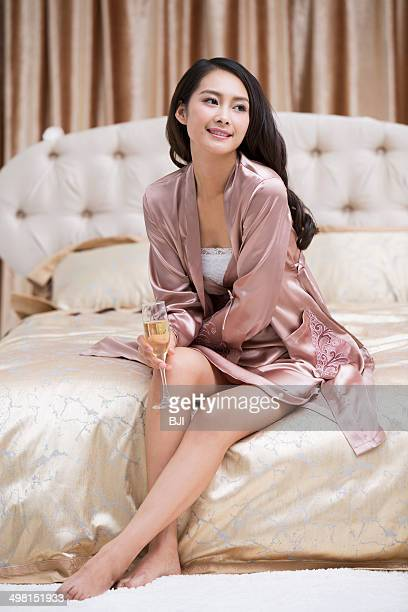 young woman with champagne - women in slips stock photos and pictures