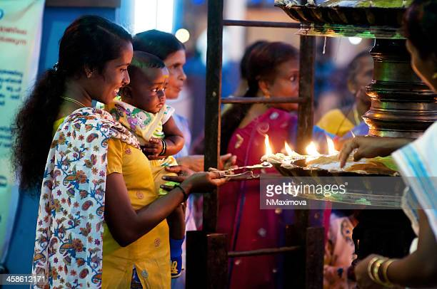 young woman with child in the temple - god stock pictures, royalty-free photos & images