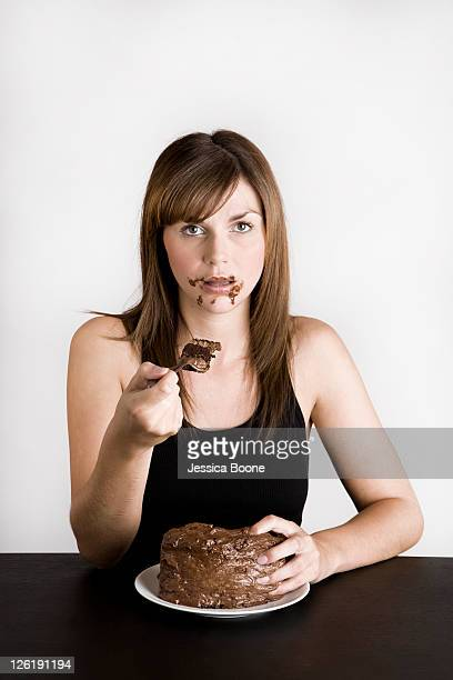 young woman with chocolate cake