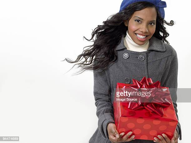 Young woman with christmas gift