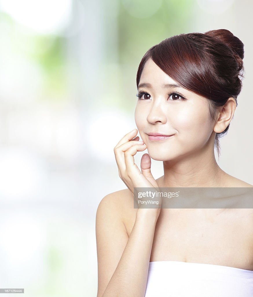 young woman with clean skin of the face : Stock Photo