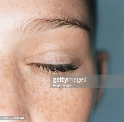 young woman with closed eye closeup stock photo getty images