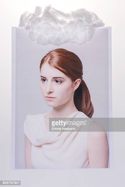 Young woman with cloud above