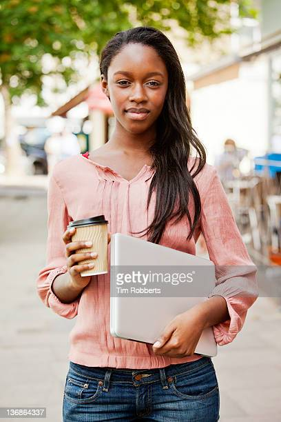 Young woman with coffee and laptop.