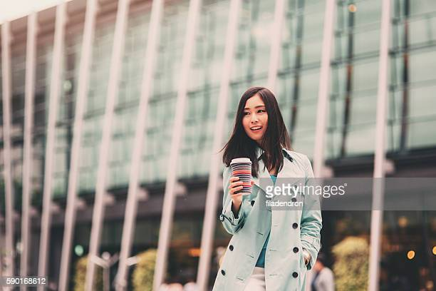young woman with coffee cup on the street - beautiful japanese girls stock photos and pictures