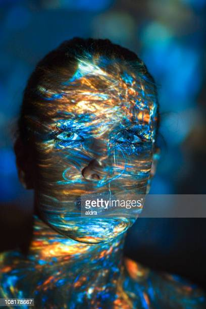 Young Woman with Colored Light Shadows All Over Face