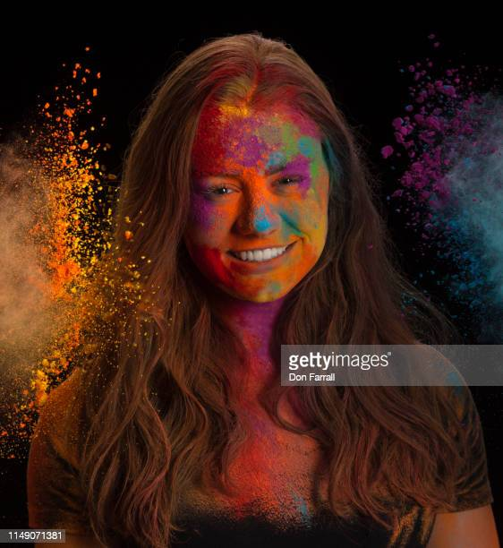 young woman with colored powder - don farrall stock pictures, royalty-free photos & images
