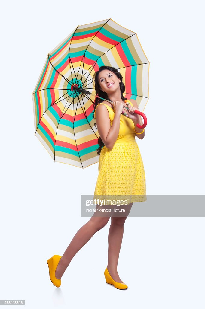 Young woman with colourful umbrella : Stock Photo