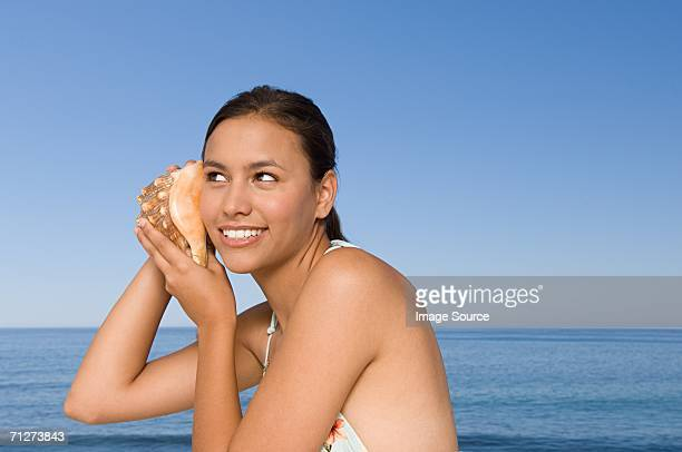 young woman with conch shell - conch shell stock pictures, royalty-free photos & images
