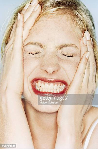 young woman with contorted face - human gums stock photos and pictures