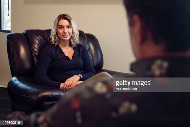 """young woman with counselling therapist in office. - """"martine doucet"""" or martinedoucet stock pictures, royalty-free photos & images"""