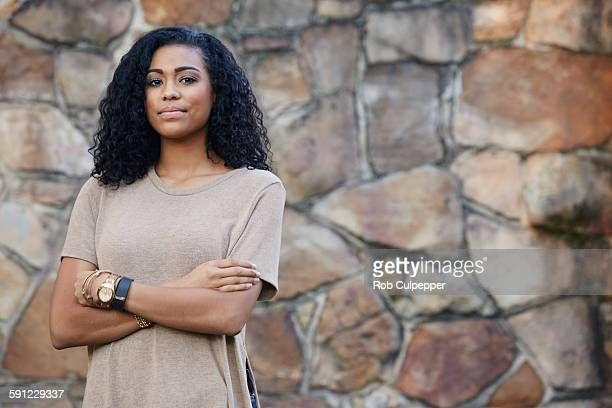 young woman with crossed arms - watch timepiece stock pictures, royalty-free photos & images