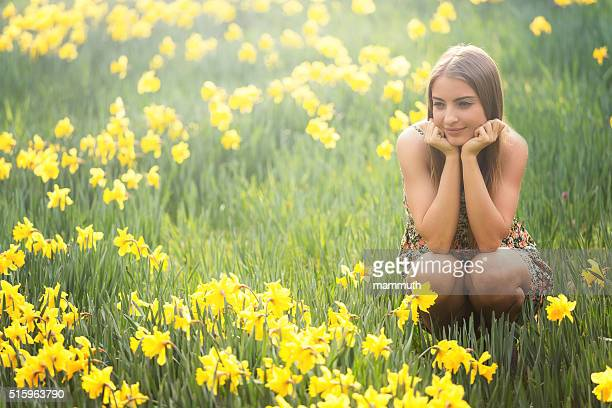 young woman with daffodils - march month stock pictures, royalty-free photos & images
