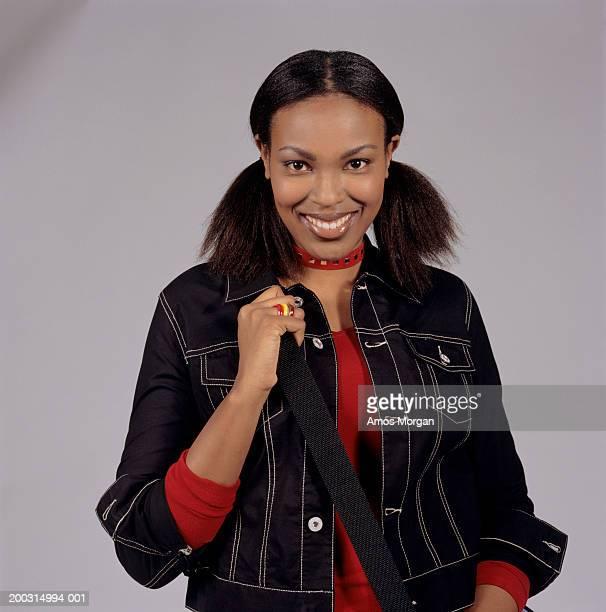 young woman with dark hair, smiling, posing in studio, portrait - paardenstaart haar naar achteren stockfoto's en -beelden