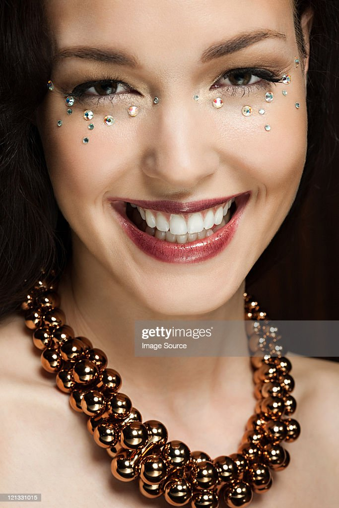 Young woman with diamonds on face, portrait : Stock Photo