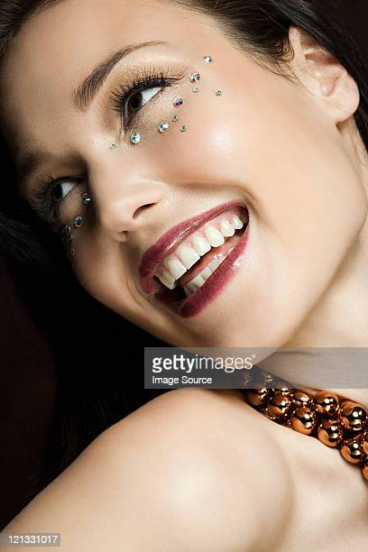 Young woman with diamonds on face, portrait