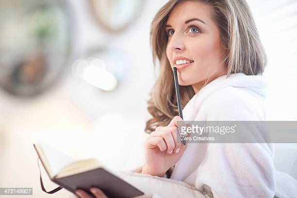 Young woman with diary and pen
