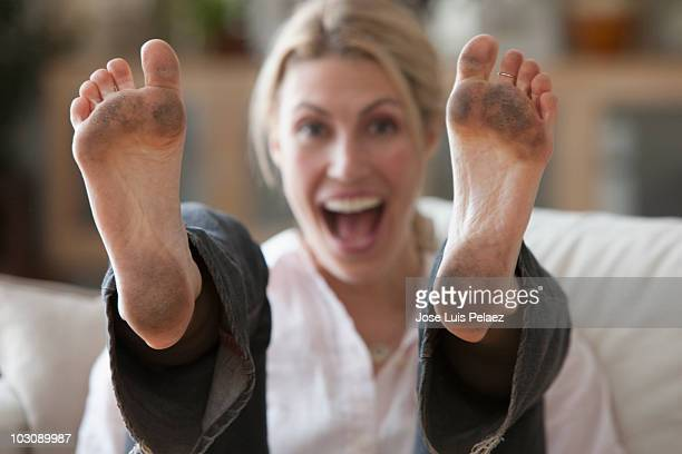 young woman with dirty feet - female feet soles stock photos and pictures