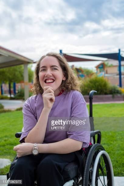 a young woman with disabilities in a wheelchair - persons with disabilities stock pictures, royalty-free photos & images