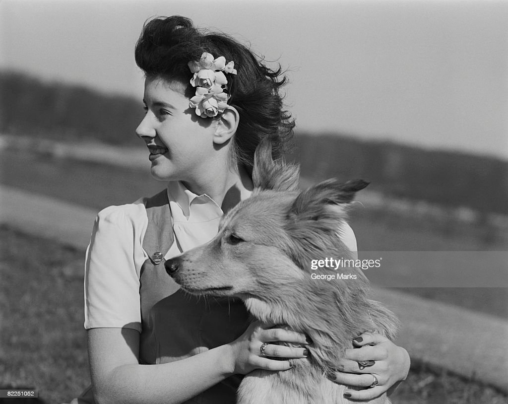 Young woman with dog outdoors : Stock Photo