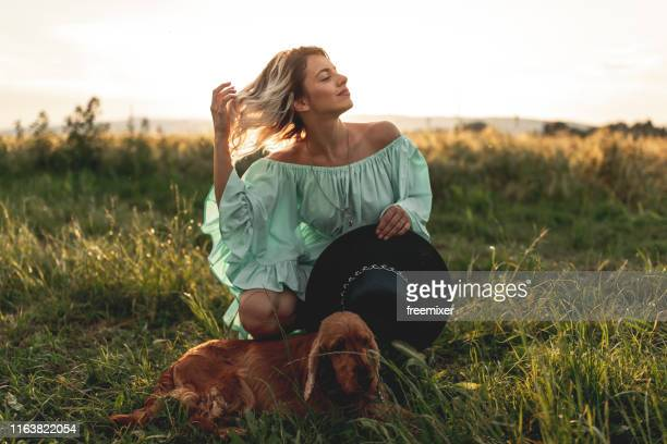 young woman with dog - green dress stock pictures, royalty-free photos & images