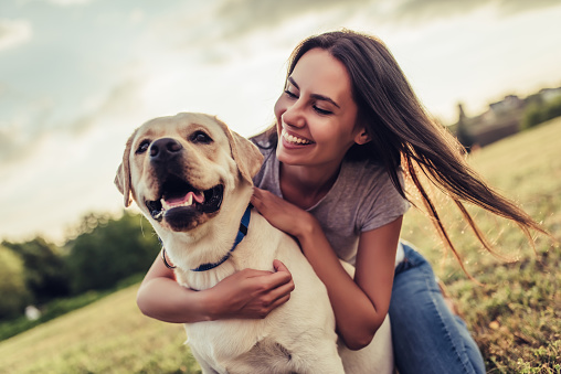 Young woman with dog 942616500