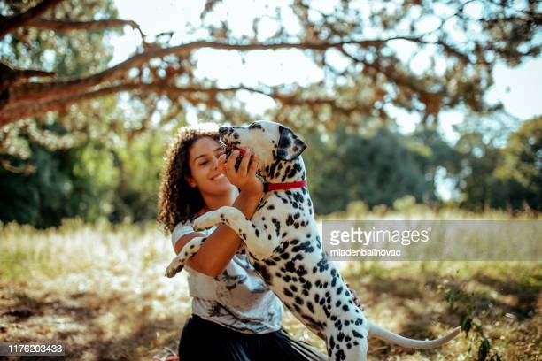 young woman with dogs - dalmatian dog stock pictures, royalty-free photos & images