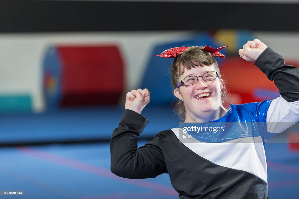 Young woman with down syndrome in gym : Stock Photo