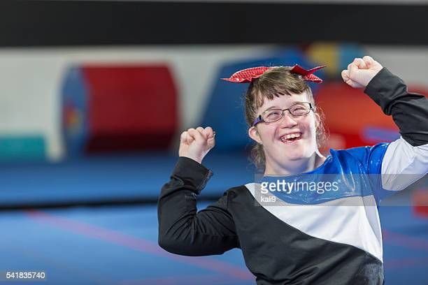 young woman with down syndrome in gym - candid cheerleaders stock photos and pictures