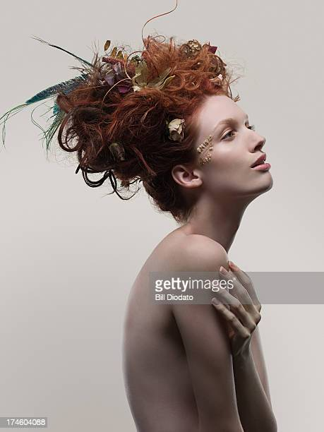 Young woman with dried flowers in hair