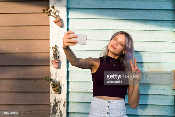 Young woman with dyed hair taking a selfie