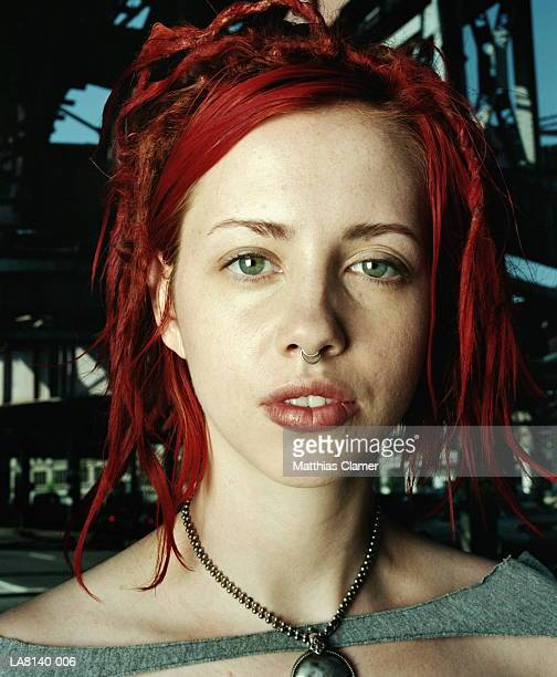 Young woman with dyed red hair and nose ring, head shot, portrait