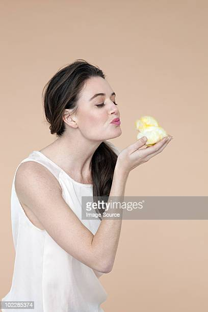 Young woman with easter chick