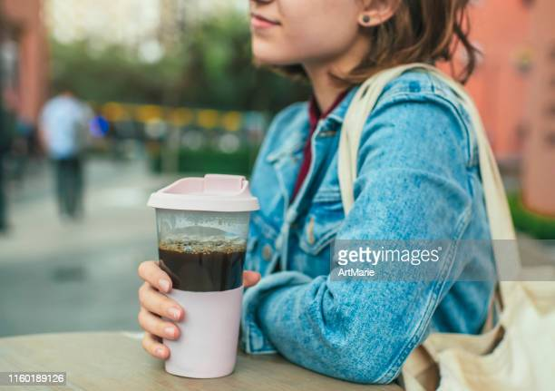young woman with eco-friendly reusable coffee cup and cotton bag, zero waste concept - reusable stock pictures, royalty-free photos & images