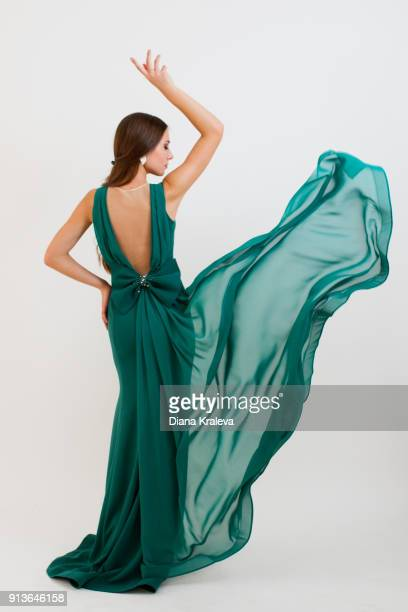 young woman with elegant green dress - kleid stock-fotos und bilder