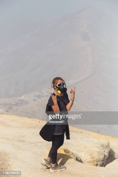 young woman with espirator mask at ijen volcano, java, indonesia - java stock pictures, royalty-free photos & images