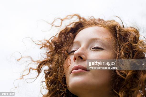young woman with eyes closed and serene expression on face, portrait - curly stock pictures, royalty-free photos & images