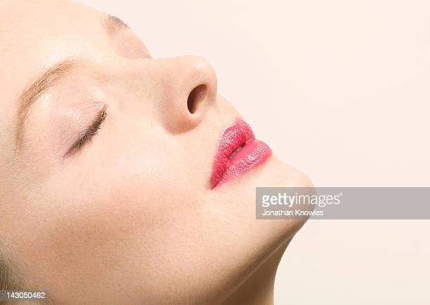 young woman with eyes closed, close up - pink lipstick stock photos and pictures