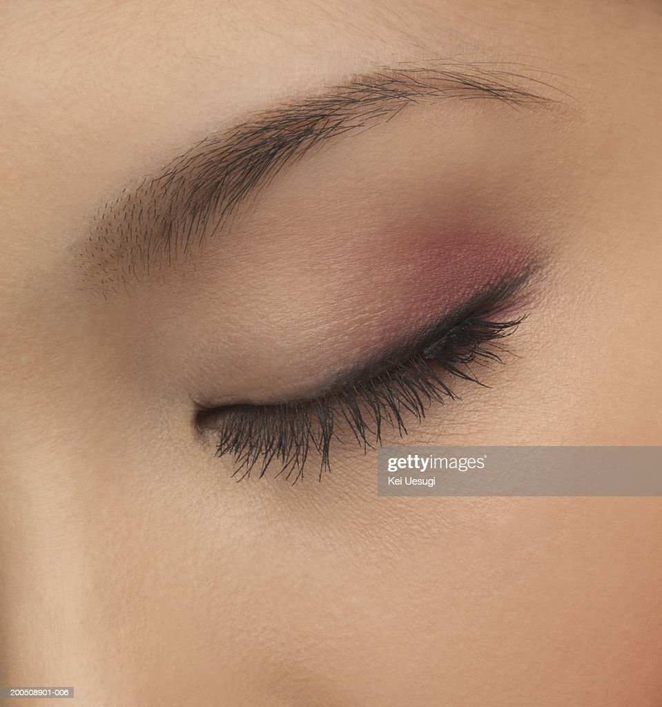 Young woman with eyes closed, close-up of eye : Stock Photo