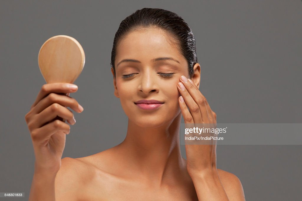 woman holding hand mirror. Young Woman With Eyes Closed Holding Hand Mirror : Stock Photo M