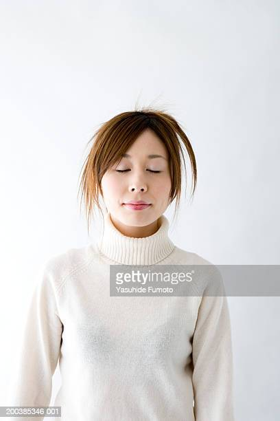 young woman with eyes closed - turtleneck stock pictures, royalty-free photos & images